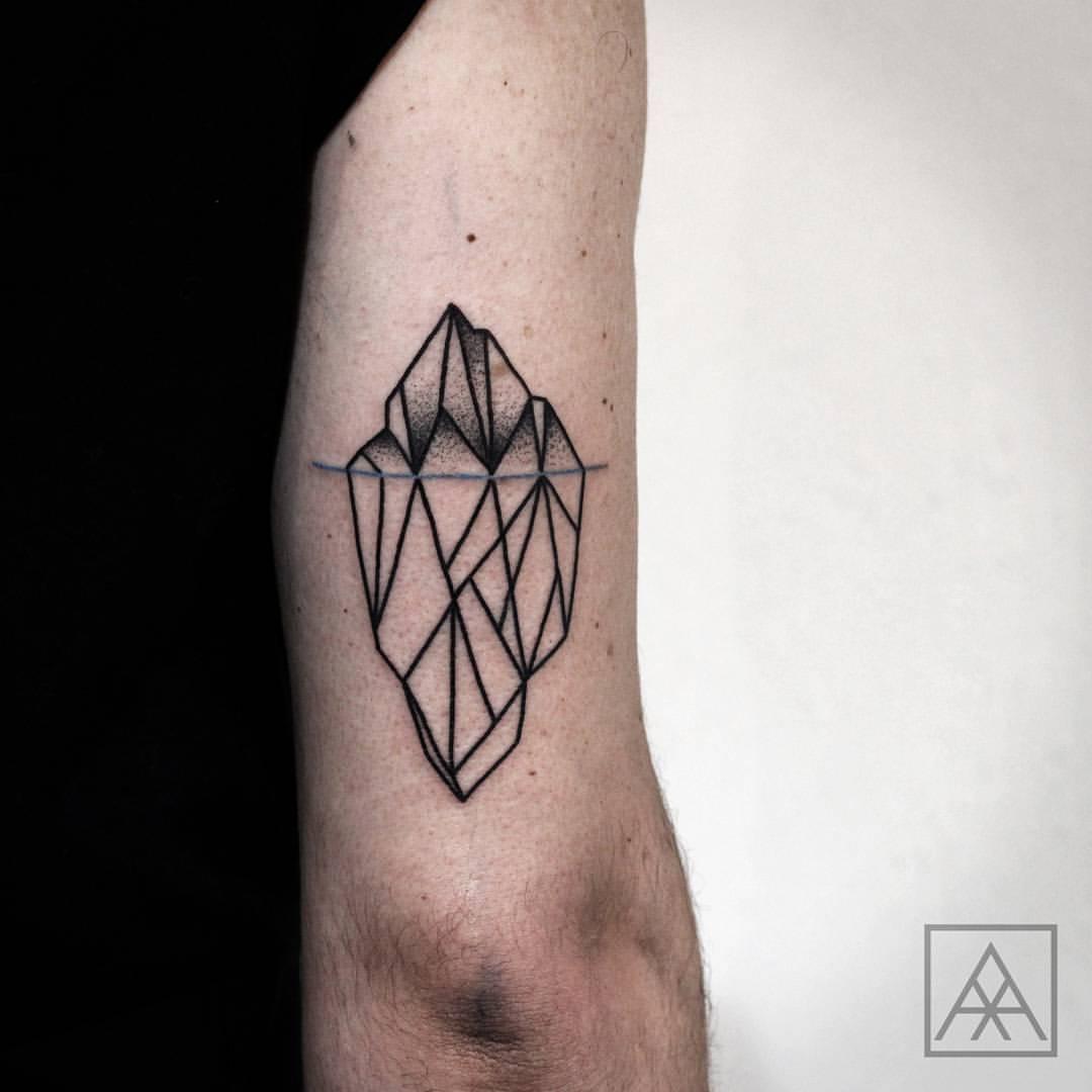 Minimalist iceberg tattoo