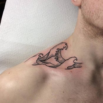Minimalist wave tattoo on the neck