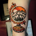 Mountainous globe tattoo