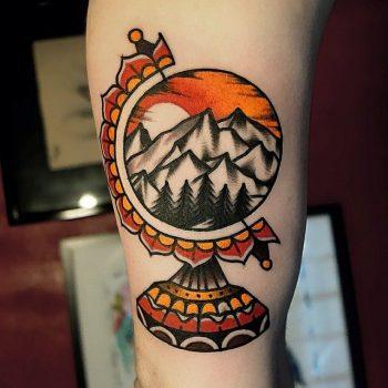 Mountainous globe tattoo