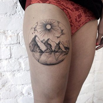 Mountains and lake tattoo on the thigh