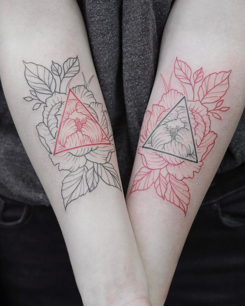 Negative space black and red tattoo