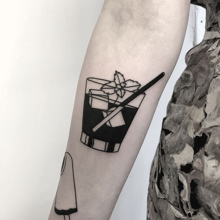 Negative space cocktail tattoo