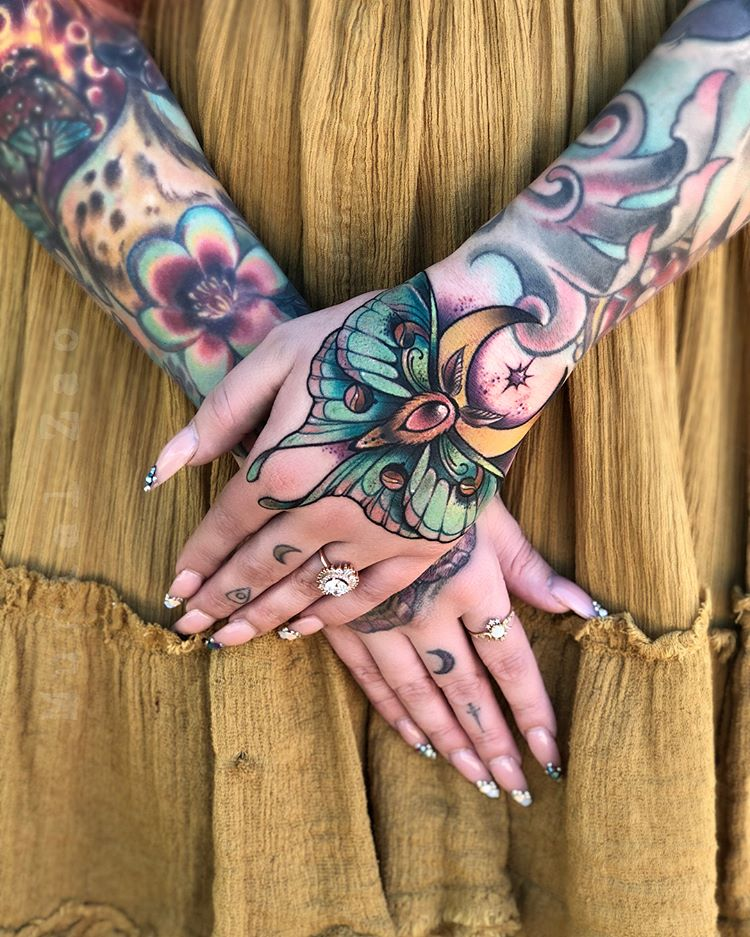 Neotraditional style tattoos on arms
