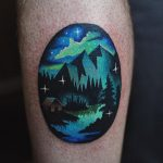 Northern lights landscape tattoo