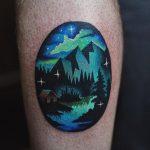 Northern lights landscape tattoo