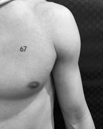Number 67 tattoo