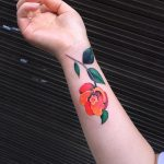 Orange and red flower tattoo