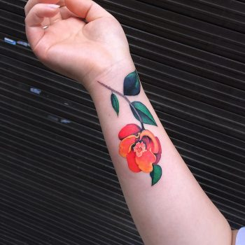Orange and red flower tattoo