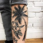 Palm tree and dino skull tattoo