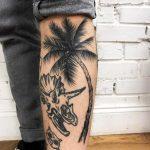Palm tree and dino skull tattoo