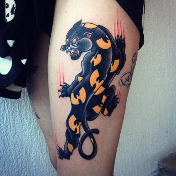Panther with yellow patches tattoo