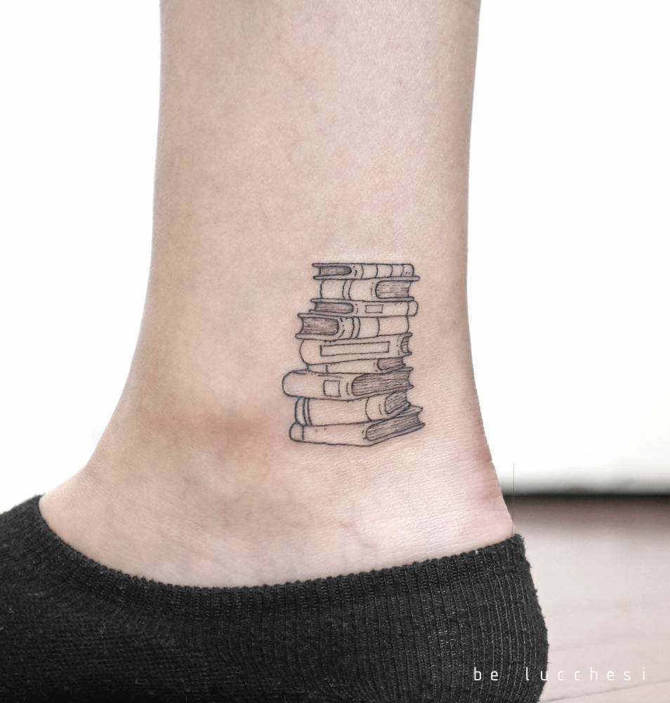 Pile of books tattoo