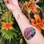 Pink circular flower tattoo