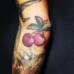 Pixel art cherries tattoo