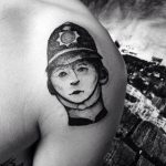 Post ironic tattoo of a 1940s british policeman