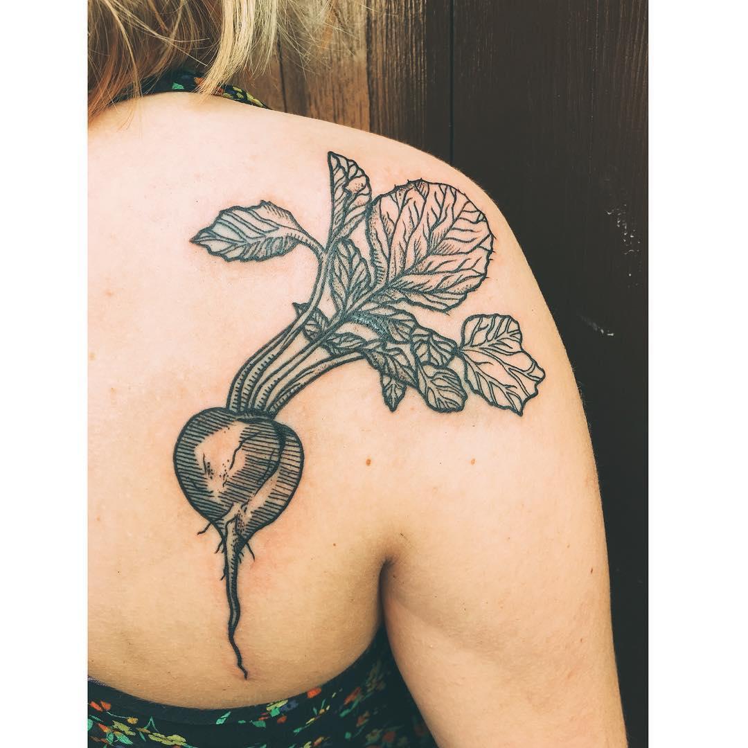 Radish tattoo on the back