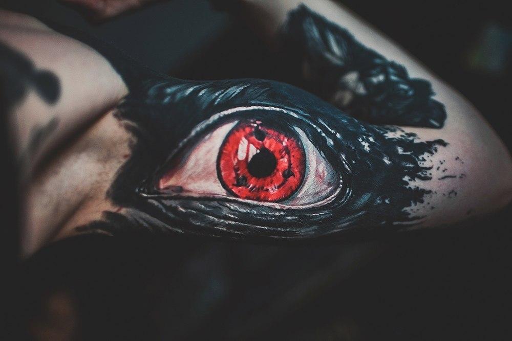Realistic eye tattoo on the bicep