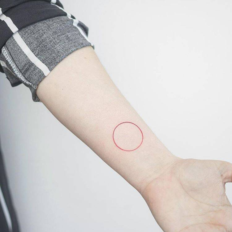 Red gradient circle tattoo