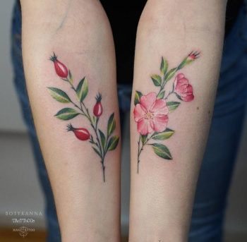 Ref and green flowers on both forearms