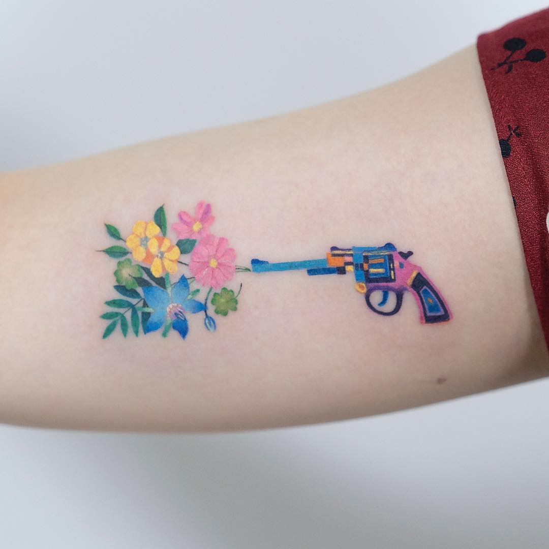 Revolver and flowers