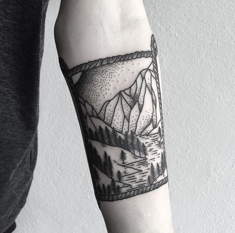 Rope framed landscape tattoo