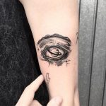 Saturn as an eyeball tattoo