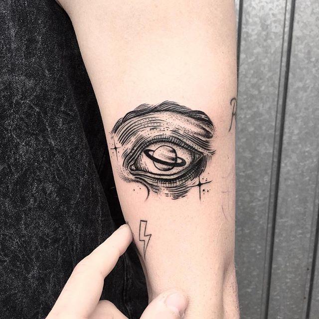 Saturn as an eyeball tattoo