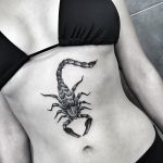 Scorpion tattoo on the belly