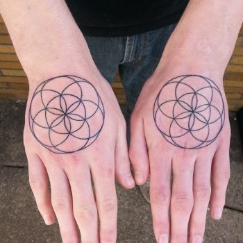 Seed of life tattoos on hands