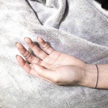 Single line wristband tattoo