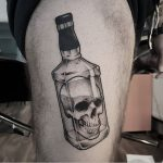 Skull in a bottle tattoo