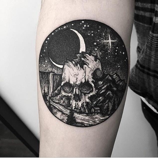 Skull in the landscape tattoo