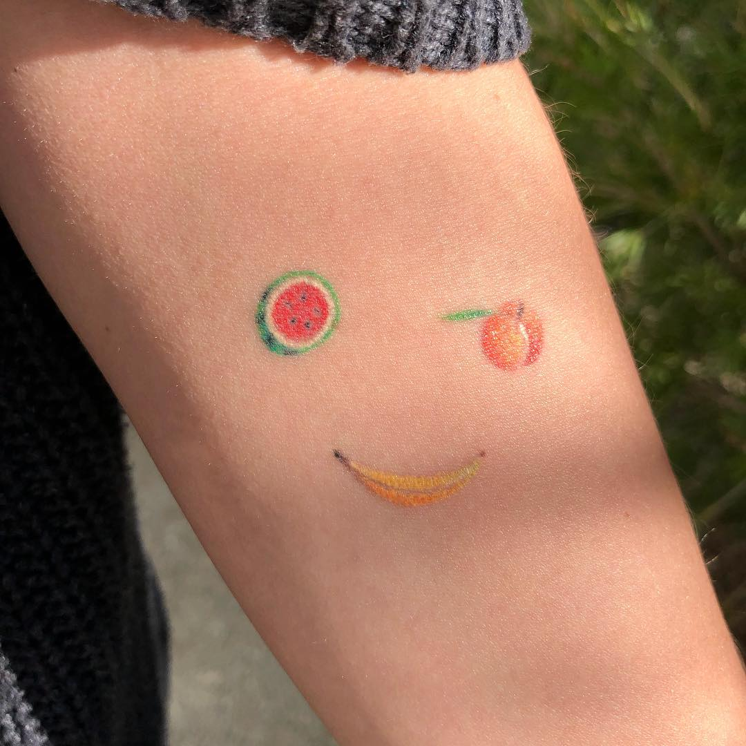 Smiley fruits tattoo