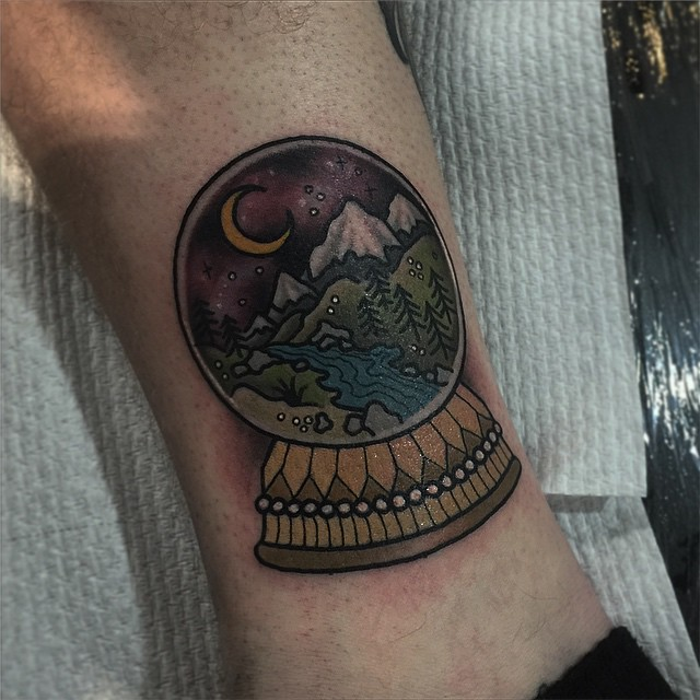 Snow globe with a landscape tattoo