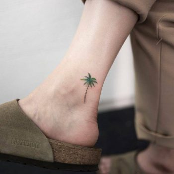Subtle palm tree tattoo on the ankle