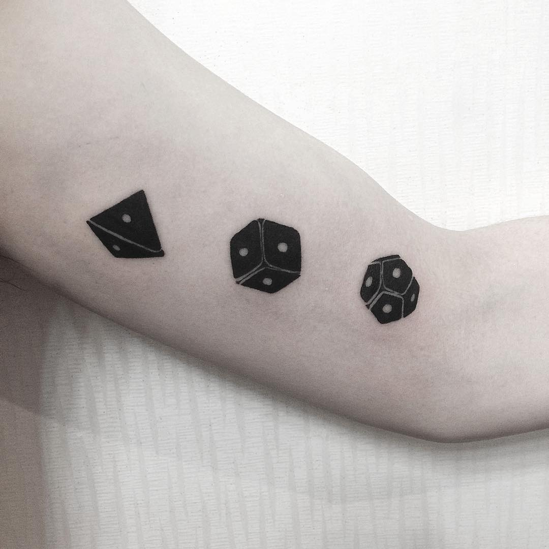 Three dices tattoo