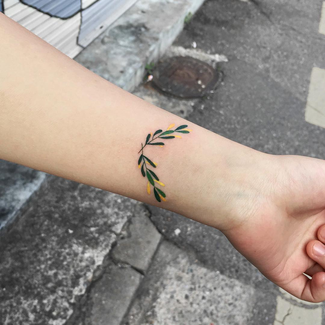 Tiny branches tattoo on the wrist