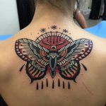 Traditional butterfly and sun tattoo on the back