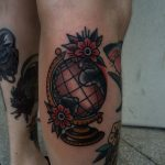 Traditional globe and flowers tattoo