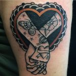 Traditional tattoo of holding hands