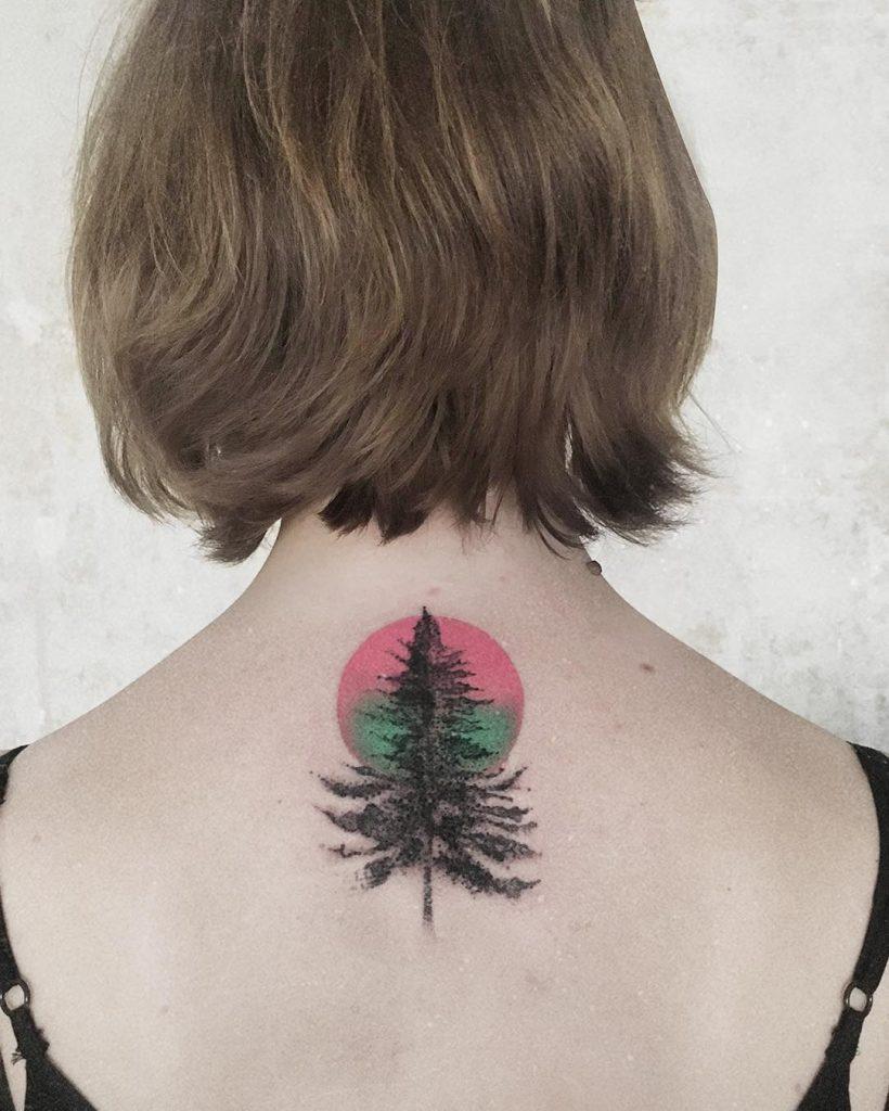 Tree and pink circle tattoo
