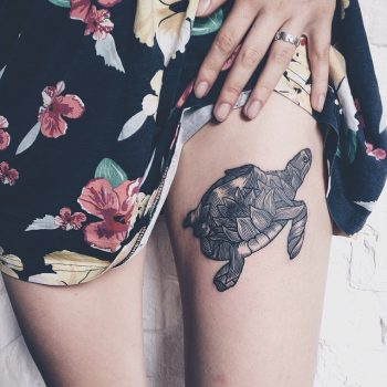 Turtle tattoo on the left thigh