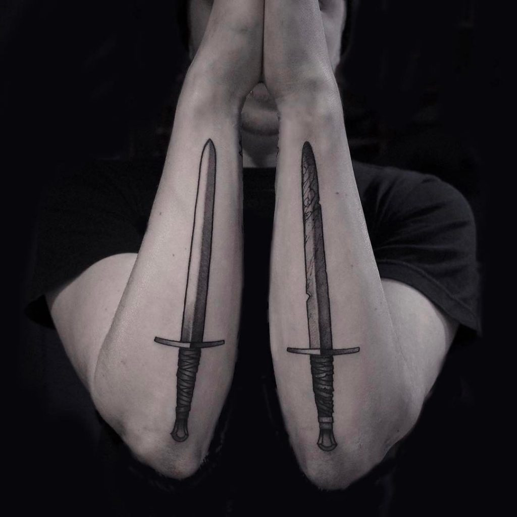 Two short sword tattoos