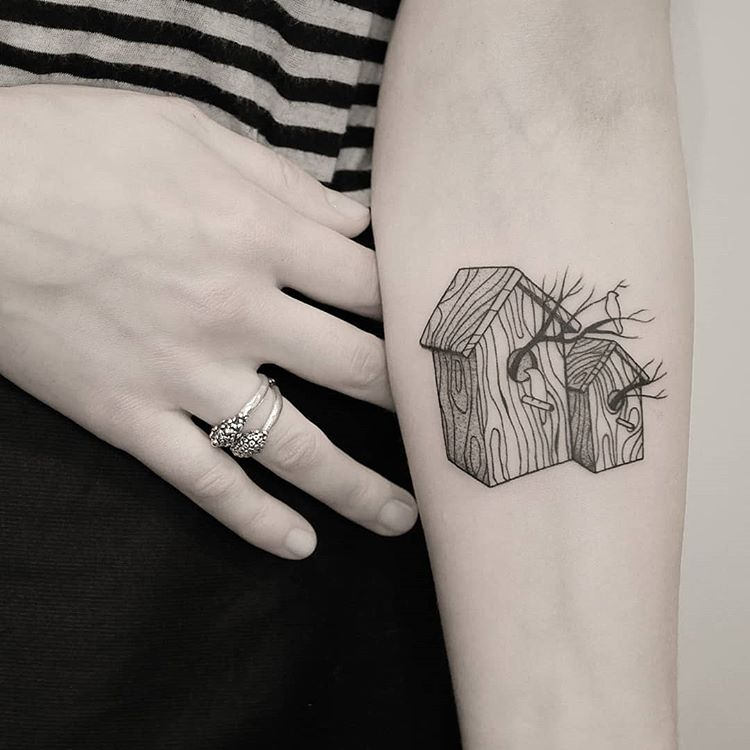 Two wooden bird houses tattoo