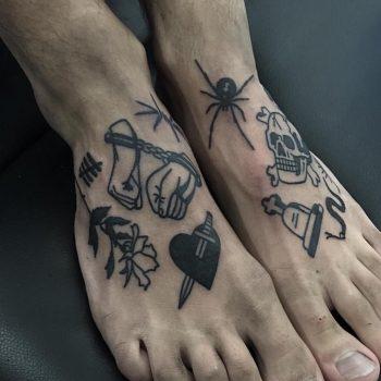 Various black tattoos on feet