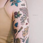 Various flower tattoos on the left arm