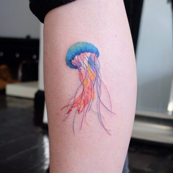 Watercolor jellyfish tattoo on the calf
