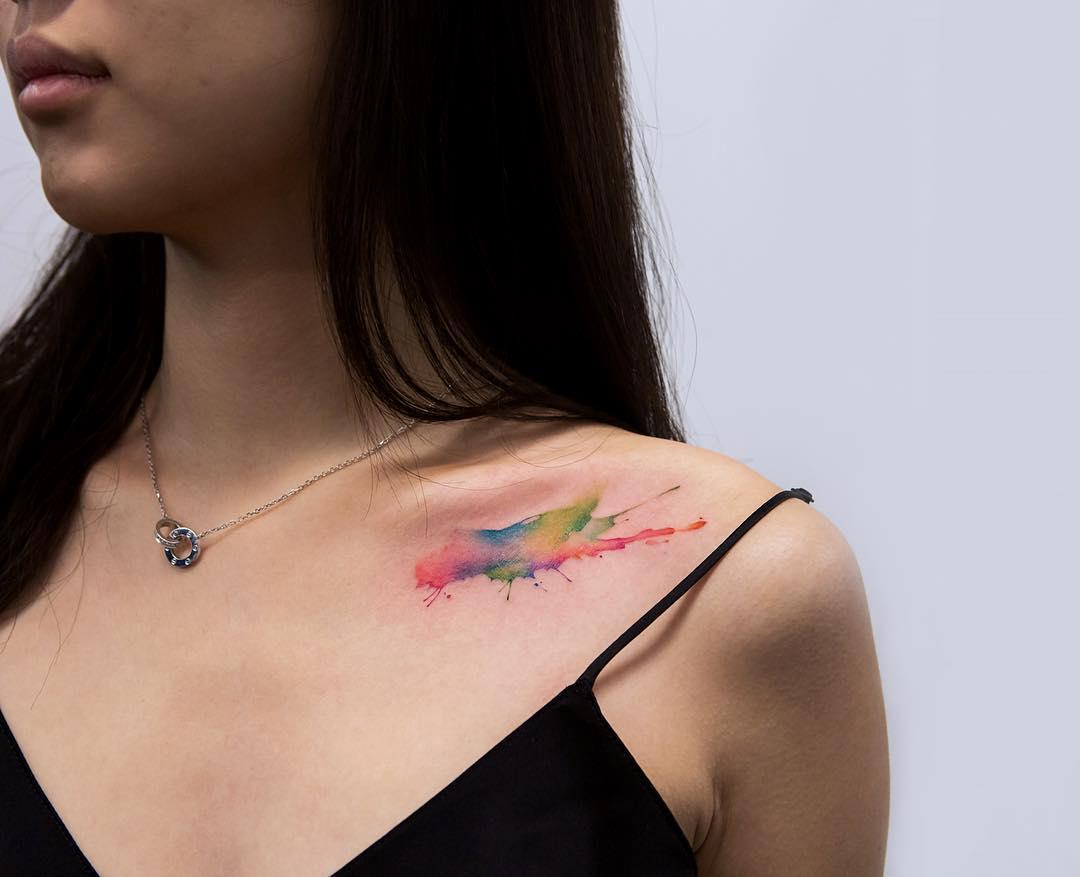 Watercolor paint splash tattoo