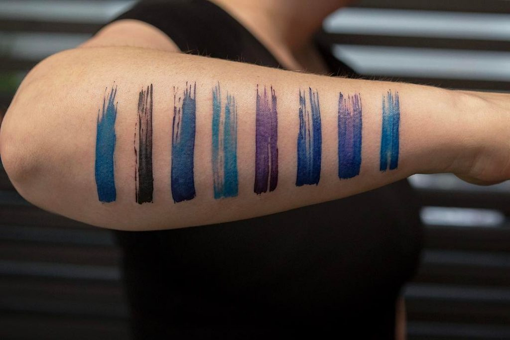 Watercolor stripes tattoo